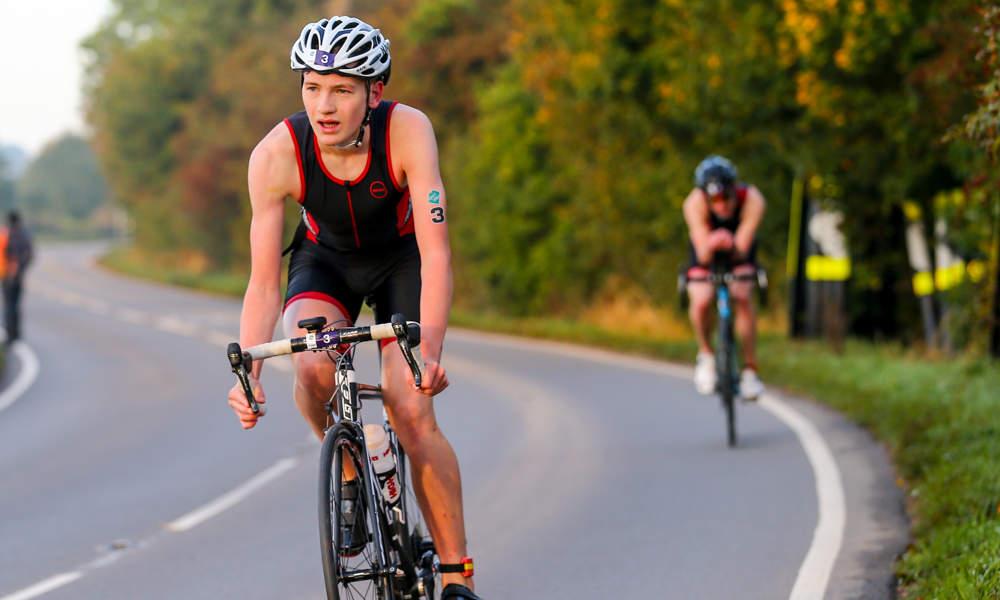 Junior triathlete biking